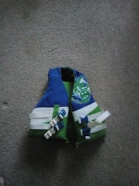 toddler's blue, white, and green life vest 35 km