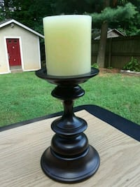 Two cherrywood candle holders with candles include Woodbridge, 22193