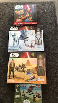 three Star Wars labeled boxes and Army box Chesapeake, 23320