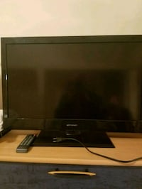 black flat screen TV with remote Grovetown, 30813