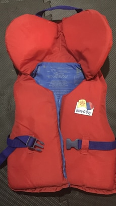 red and blue full zip buoy-o-boy life vest