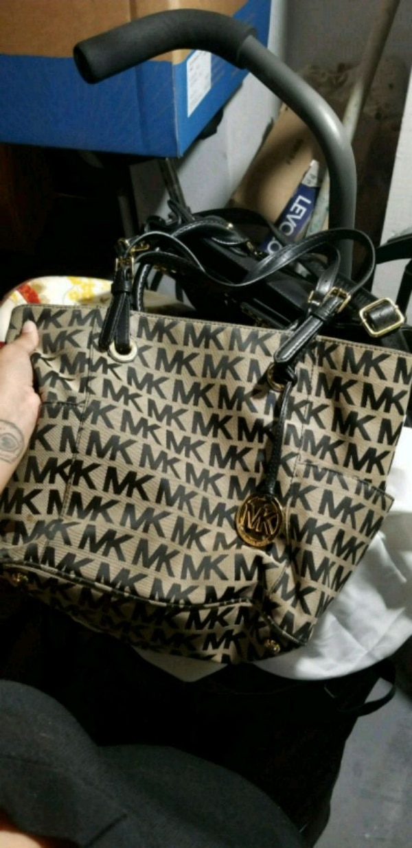 e35ed07fd4e9 Used black and brown Michael Kors monogram tote bag for sale in West Orange  - letgo