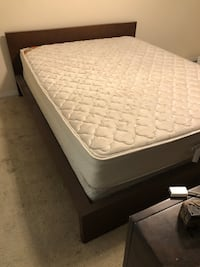 white and black mattress with brown wooden bed frame Tampa, 33612