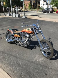 orange and black chopper motorcycle New York, 10309