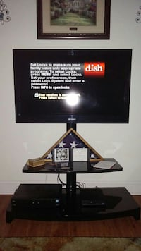 black flat screen TV with stand