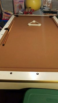pool table with pool cues