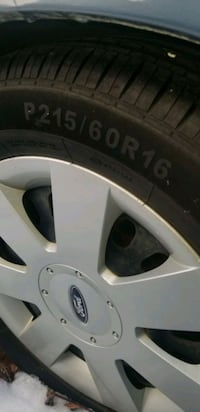 "Tires new ..215/60/16""  on rims for 2001 Ford Taurus"