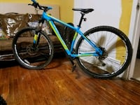 blue and black hardtail bike 230 mi