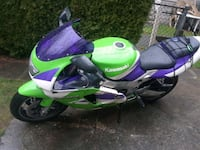 green and purple motor scooter 2283 mi