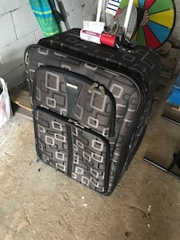 black and gray soft shell luggage