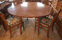 Oval brown wooden table with four chairs dining set Fredericksburg, 22406