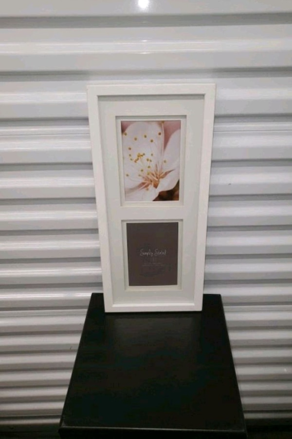 white wooden framed with glass