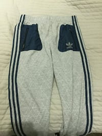 black and gray adidas track pants 548 km