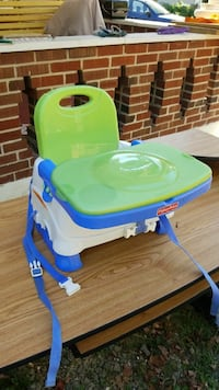 baby's green and blue Fisher Price high chair