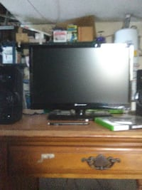 black flat screen TV with remote LOSANGELES