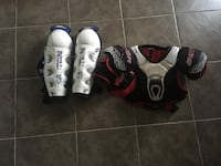 pair of white shin guards and chest pad Martensville, S0K 2T0
