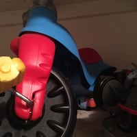 toddler's red, blue, and black plastic bicycle
