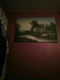 brown wooden framed painting of house 426 mi