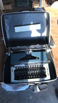 Black and gray typewriter with case Vaughan, L4L 2P9