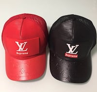 two black and red fitted caps
