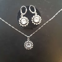 silver-colored-and-diamond studded pendant necklace and earrings