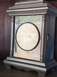 Clock with hidden compartment