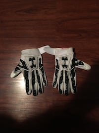 pair of white-and-black Under Armour gloves