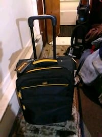 Lucas Luggage pull behind suitcase on wheels