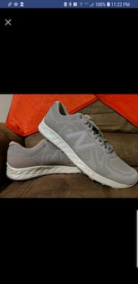 pair of gray-and-white Nike running shoes Salem, 36874