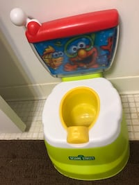 Baby's white and yellow potty trainer 31 km