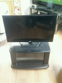 black flat screen TV with black wooden TV stand Edmonton, T5C 1V3