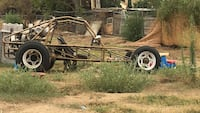 Brown dune buggy 222 mi