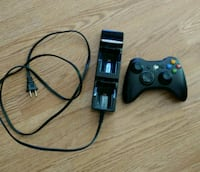 black Xbox 360 game controller with charger Burnaby, V3N