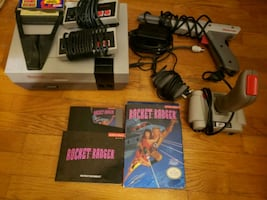 Nes with gun, game, turbo $100