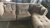 tufted brown fabric sectional sofa with throw pillows