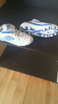 unpaired white and blue Adidas cleats Chilliwack, V2P 4E7