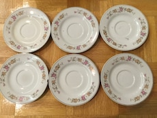 six white and red floral ceramic plates
