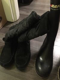pair of black leather boots 3139 km