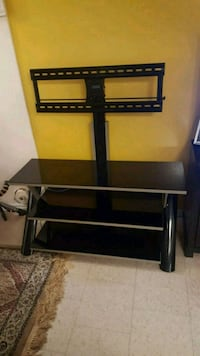 black metal and glass TV mount with mount Toronto, M6E