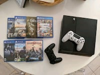 PlayStation 4 with 7 games, 2 controllers, and PlayStation camera.