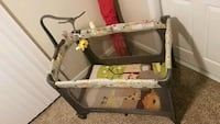 baby's gray and white travel cot