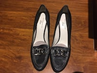 Pair of black leather loafers 556 km