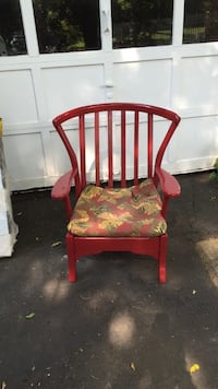 Red wooden cushioned armchair