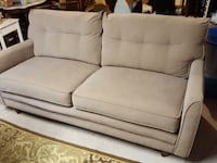 Beige fabric sofa couch