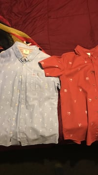 two gray and red buttoned collared shirts