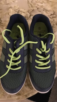 pair of black-and-green Athletic works running shoes