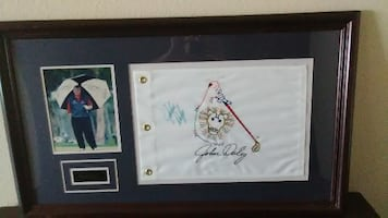 John Daly autographed picture framed.