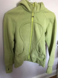 green zip-up jacket