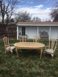 Oval brown wooden table with four chairs dining set.  Table needs refinishing.  Chairs in excellent condition. Littleton, 80120