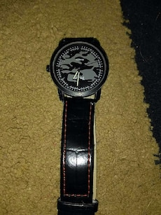 round grey and black analog watch with black leather band